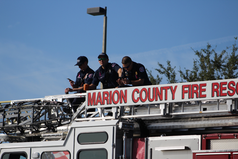 Firefighters watch the move. (Jessica Korina/WUFT News)