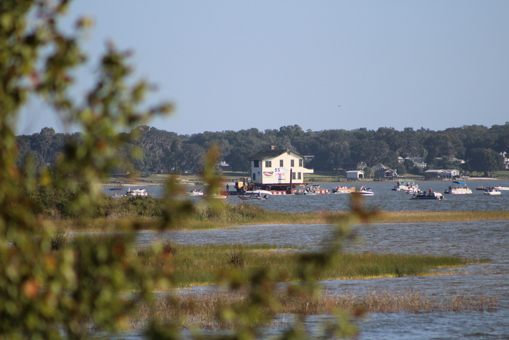 The historic Ma Barker house floats from Lake Weir to the Carney Island Recreation and Conservation area. (Jessica Korina/WUFT News)