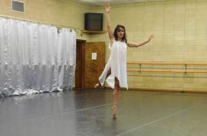 "Principal dancer Jessie Dominguez performs ""Ave Maria"" Saturday afternoon at Pofahl Studios. She performed the solo as a tribute to her father. (Jennifer Jenkins/WUFT News)"