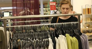 Alyssa Short, 21-year-old USF student, browses through the Belk department store racks with a friend. (Michelle Tapia/WUFT News)