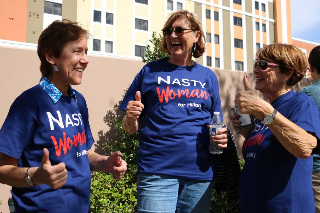 "Amy Coiro (left), Louise Villinger, and Jane Clayman wear their ""nasty women"" shirts. ""We just want a good, fair election and make the best woman win,'' Clayman said. Clinton supporters have turned Trump's ""nasty woman"" insult to Clinton at the last debate into a feminist catchphrase. (Rachel Wang/WUFT News)"
