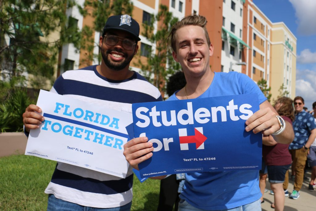 "Nyles Carter (left) and Brian Broadwell, students at Flagler University in St. Augustine, FL, said they went to the Donald Trump rally in St. Augustine Tuesday to get an unbiased look from both sides. ""The Trump rally was not culturally diverse. We feel more at home here,"" Broadwell said. (Rachel Wang/WUFT News)"