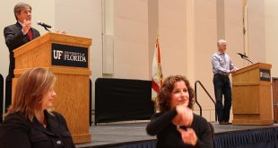 Sign language interpreters assist the audience during a debate between Rod Smith (left) and Keith Perry (right) Tuesday night at UF's Reitz Union. (Catie Flatley/WUFT News)