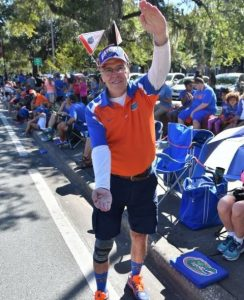 Ron Blake has lived in Gainesville since 1965 and has never missed a homecoming parade. This was his 51st parade. (Grace King/WUFT News)