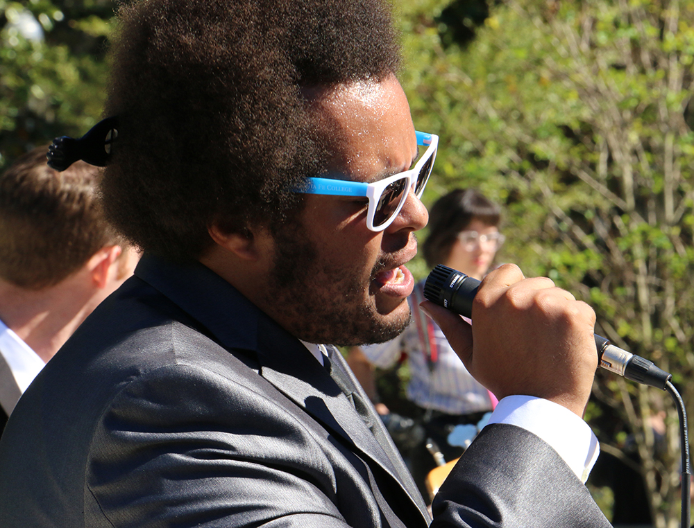 """Lead vocalist Justin McKenzie of The Savants of Soul, a Gainesville band, entertains the crowd as the audience waits for Tim Kaine to arrive. The group played the 1960 Ray Charles song """"Hit the Road Jack"""" to poke fun at Republican presidential nominee Donald Trump."""