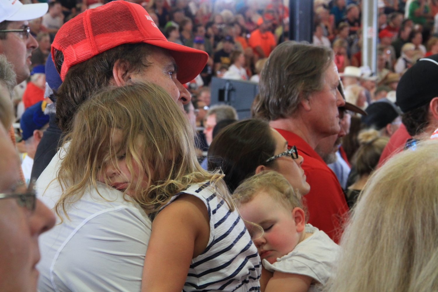 "Two children sleep during Trump's speech Wednesday afternoon. Over the course of the rally, speakers focused on the importance of this election on future generations. ""The election of Hillary Clinton would lead to the almost total destruction of this country,"" Trump said. ""This is the last chance you'll get to save your country. You're not going to get another chance."""