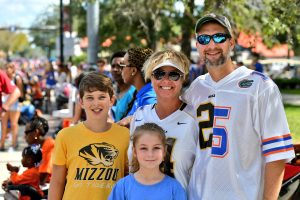 University of Missouri alum Jason Kloeppel works at UF Shands Hospital. Like his shirt, he and his family are divided on their hopes for tomorrow's game. (Grace King/WUFT News)