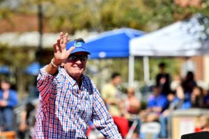 Grand Marshal and UAA ambassador Steve Spurrier kicks off the homecoming parade. (Grace King/WUFT News)
