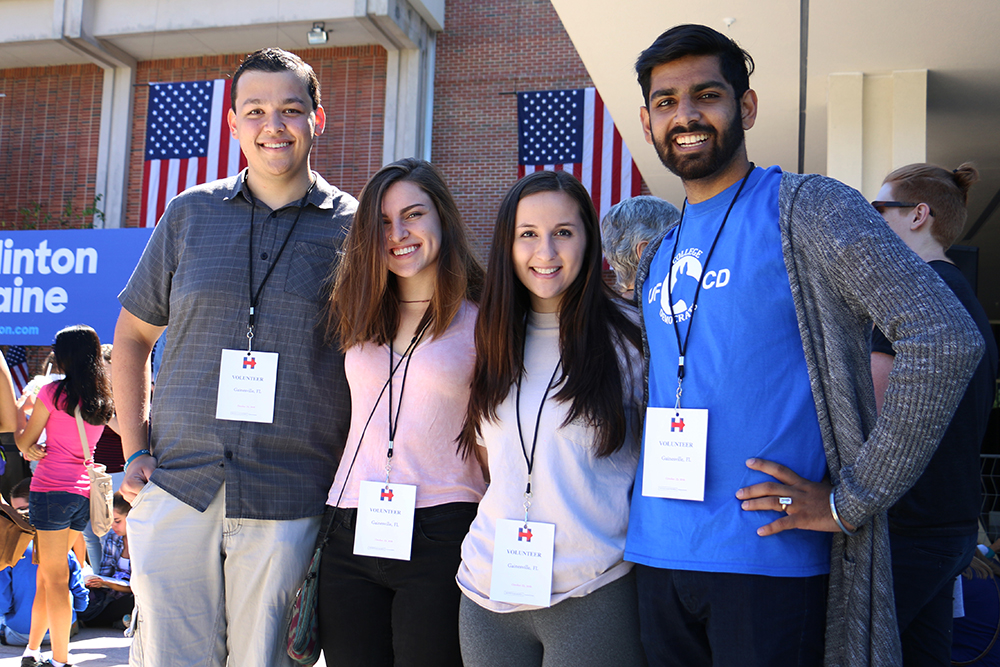 Volunteers at the rally, Fahim Chowdury (left), 18, Jocelyn Cuh, 18, Maya Schreiber, 18, and Amol Jethwani, 20, will all be first-time voters this election cycle. Chowdury, Cuh and Schreiber were all Hillary Clinton Organizing Fellows for the campaign.