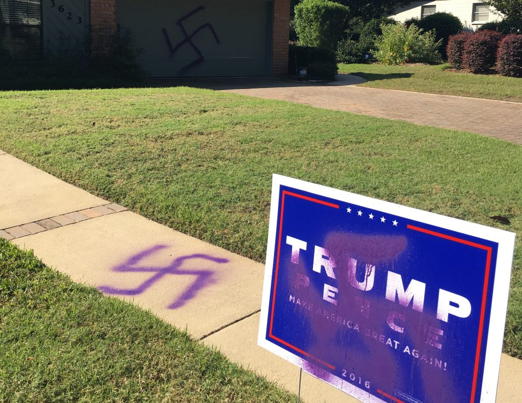 Gainesville resident Ronnie Sartain woke up to swastika symbols spray painted on his garage door, sidewalk and Trump campaign sign Wednesday, October 26, 2016. (Marcy Grace Scully/WUFT News)