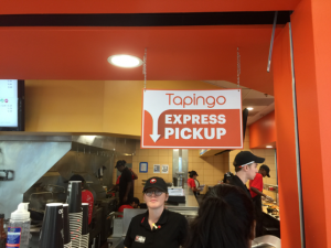 """Tapingo signs, such as this one at Panda Express in the J. Wayne Reitz Union food court, are placed at all of the University of Florida's app-designated locations. """"We had location managers go through all of the ordering processes for each menu item to make sure the menu flow for ordering an item was accurate and consistent with how a customer would order an item if they were at the actual location,"""" said Jill Rodriguez, the marketing program director at UF's Gator Dining Services. (Kyle Brutman/WUFT News)"""