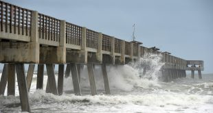 Waves crashoff the pilings under the Jacksonville Beach Fishing Pier on Wednesday, Oct. 05, 2016, as Hurricane Matthew approaches Jacksonville, Fla. (Bruce Lipsky/The Florida Times-Union via AP)
