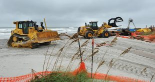 Workers remove pipes and other equipment related to a beach dredging project Wednesday in preparation for Hurricane Matthew in Jacksonville Beach. While Matthew didn't end up ravaging Florida's coast as a series of storms did a dozen years ago, it collapsed dunes, washing away sand that protected buildings and roads during storms, and will likely require the spending of millions of dollars on beach restoration projects. (Will Dickey/The Florida Times-Union via AP)