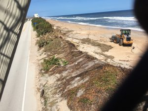 Crew working on cleaning up Vilano beach with wood from the stairs of public access bridges. Photo Courtesy of Alaina Porcellini