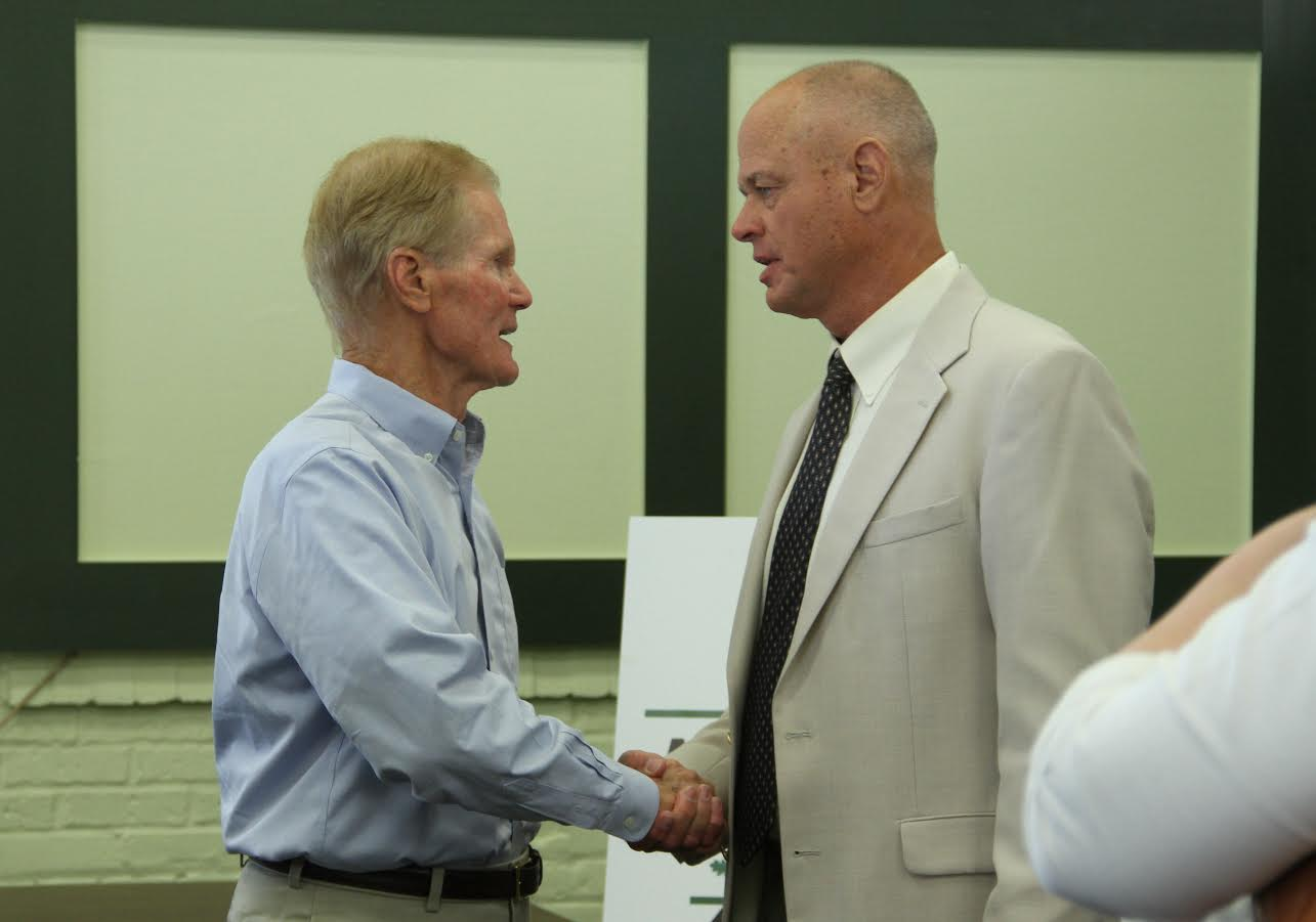 Sen. Bill Nelson (left) and Live Oak councilman Keith Mixon (right) shake hands after Nelson's talk at All Aboard Live Oak. Mixon says he has been advocating for the Amtrak stop for four years. (WUFT News/Jordanne Laurito)