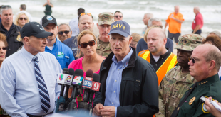 Gov. Rick Scott visited Flagler Beach Monday to tour damage caused by the hurricane. Scott also met with Florida National Guard members, Florida Power & Light utility linemen and volunteers. (Photo courtesy of Scott's office)