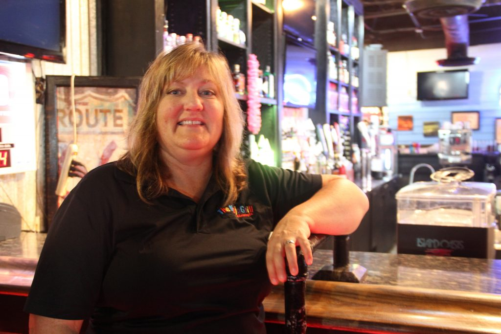 "Brandie Braddock, who moved from Salt Lake City, Utah to Ocala 13 years ago, has been manager of The Mojo Grill since the business opened in 2009. Also a Rubio supporter, Braddock said she's voting for him because ""He's looking out for our state."" (Antara Sinha/WUFT News)"
