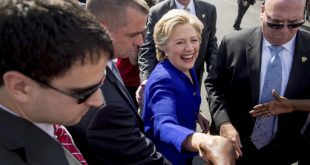 Democratic presidential candidate Hillary Clinton greets people outside an early voting center in Lauderhill, Fla., Wednesday, Nov. 2, 2016. (AP Photo/Andrew Harnik)