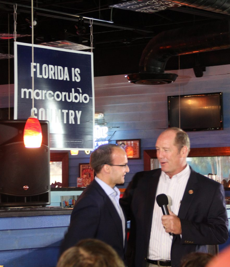"Ted Yoho, state representative for Florida's third congressional district, introduced Rubio to the audience with Paul Skinner. Yoho spoke about Rubio's Cuban-American heritage and said that Rubio ""exemplifies and epitomizes the American Dream."" (Antara Sinha/WUFT News)"