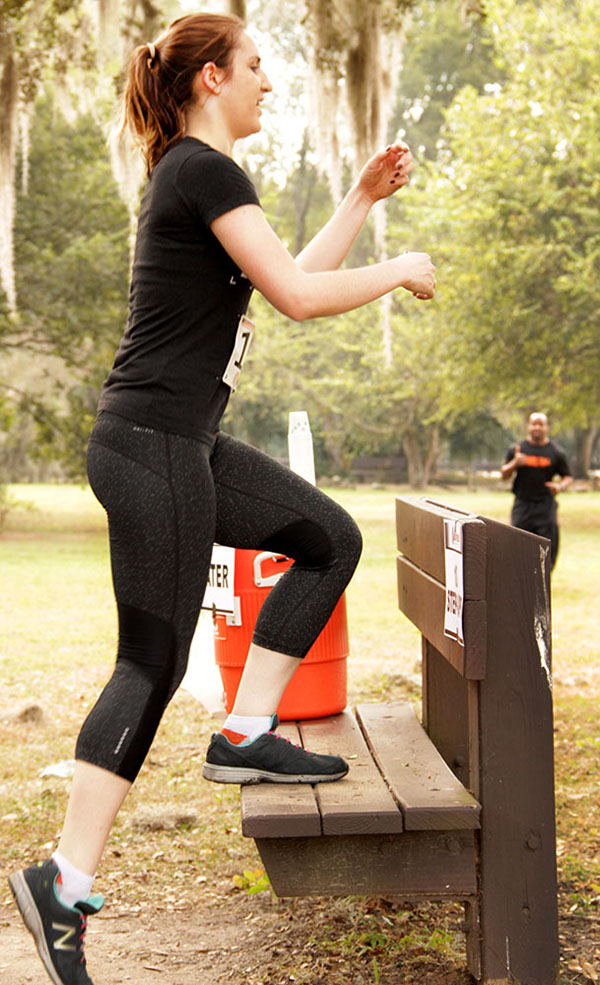 UF grad student Melissa Hoffmann starts to count out 10 step-ups before continuing the 5K run and obstacle course. (Photo by Neosman Flores/WUFT News)