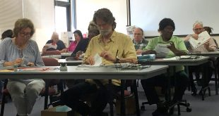 Alachua County Supervisor of Elections staff count and sort ballots during a canvassing meeting on Nov. 1. Thanks to a new Florida law, the several hundred Alachua County voters who would have previously had their ballots not counted because of mismatched signatures had the chance to fix the signatures in the elections earlier this month. (File/WUFT News)