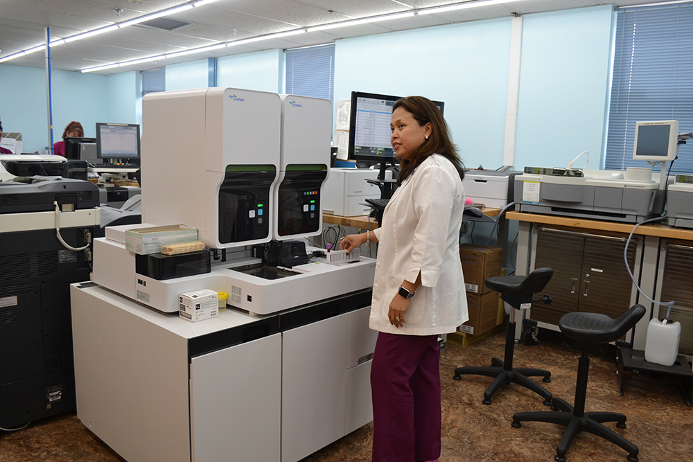 Arseli Encienzo, the lab director at Regional General Hospital, is using the Sysmex XN-2000, a hematology system that processes about 200 blood samples per hour. (Elayza Gonzalez/WUFT News)