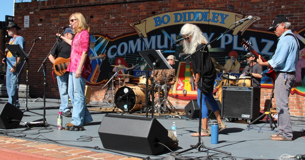The Shambles, a local rock 'n' roll cover band performs at Bo Diddley Plaza for Gainesville's 35th annual Downtown Festival and Art Show. (Photo by Kayla Ziadie)
