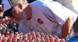 "Michael A. Perry sells his commemorative Coca-Cola bottles at the garage sale. He says he was ""selling off the duplicates."" He has a warehouse with over 10,000 unopened Coca-Cola bottles. The one's being sold are just extra's from the same year. (WUFT News/ Tangela Morris)"