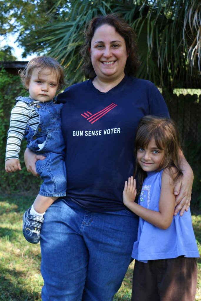 "Amy Gorelick with her children, Melanie Hendricks, 5, and Graham Hendricks, 1, at the Caribbean Queen restaurant. ""I had to come and meet the first president I ever voted for back in 1996,"" Gorelick said. She said Clinton picked up Graham and took a photo with him. (Rachel Wang/WUFT News)"
