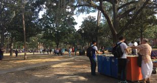 University of Florida students pick up Hare Krishna lunch Monday at the University of Florida's Plaza of the Americas. Renovations on the plaza, which include better drainage to prevent grass-killing flooding, are set to start this week. (Mariana Riquezes/WUFT News)