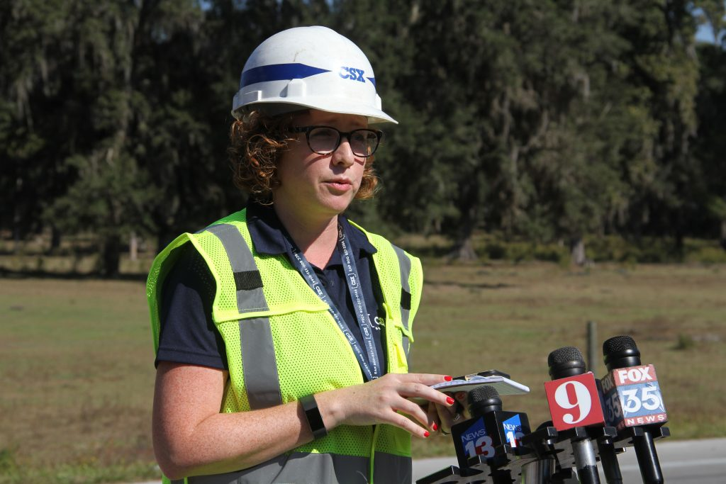 Laura Phelps, a spokesperson for CSX, addresses the media Wednesday morning. Phelps said that no major injuries were reported after the crash, but that an unknown amount of diesel fuel leaked out of one of the trains.
