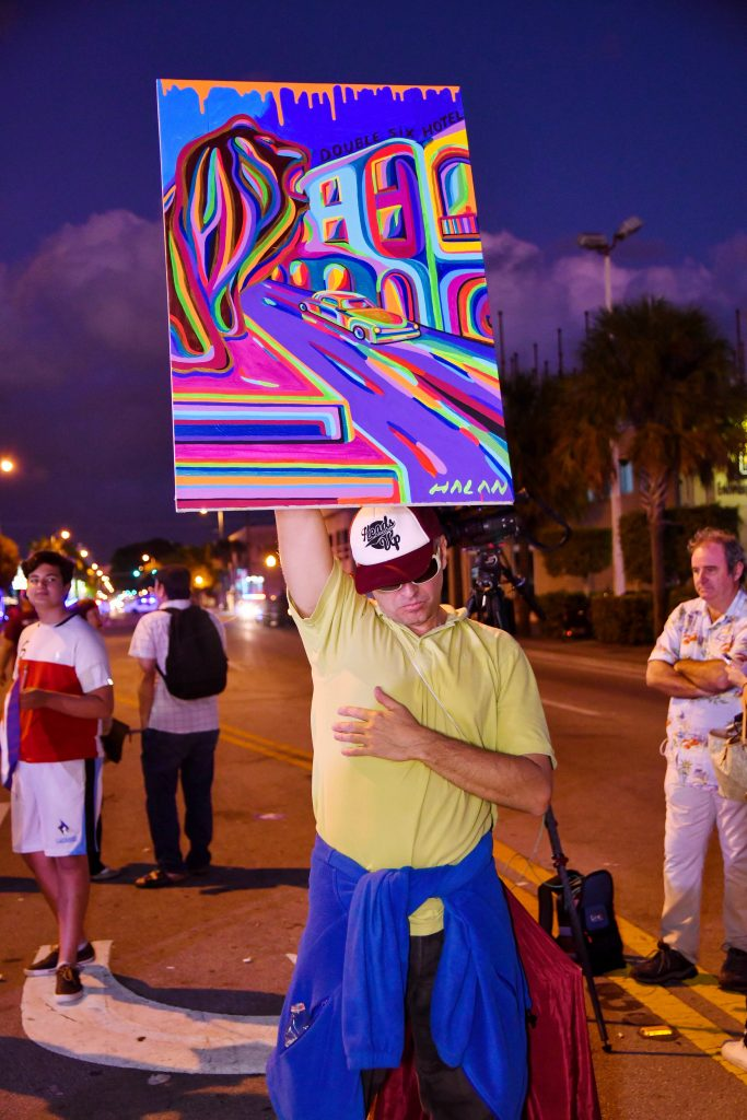 "Halan Lopez holds up a painting representing the freedom of Cuba. He described himself as the ""Statue of Liberty"" for Cuba and said he was making a ""small sacrifice for the freedom of Cuba."" (Grace King/ WUFT News)"