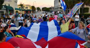 Cubans celebrate in the streets of Miami, Fla. after the death of Cuban dictator Fidel Castro. (Grace King/ WUFT News)