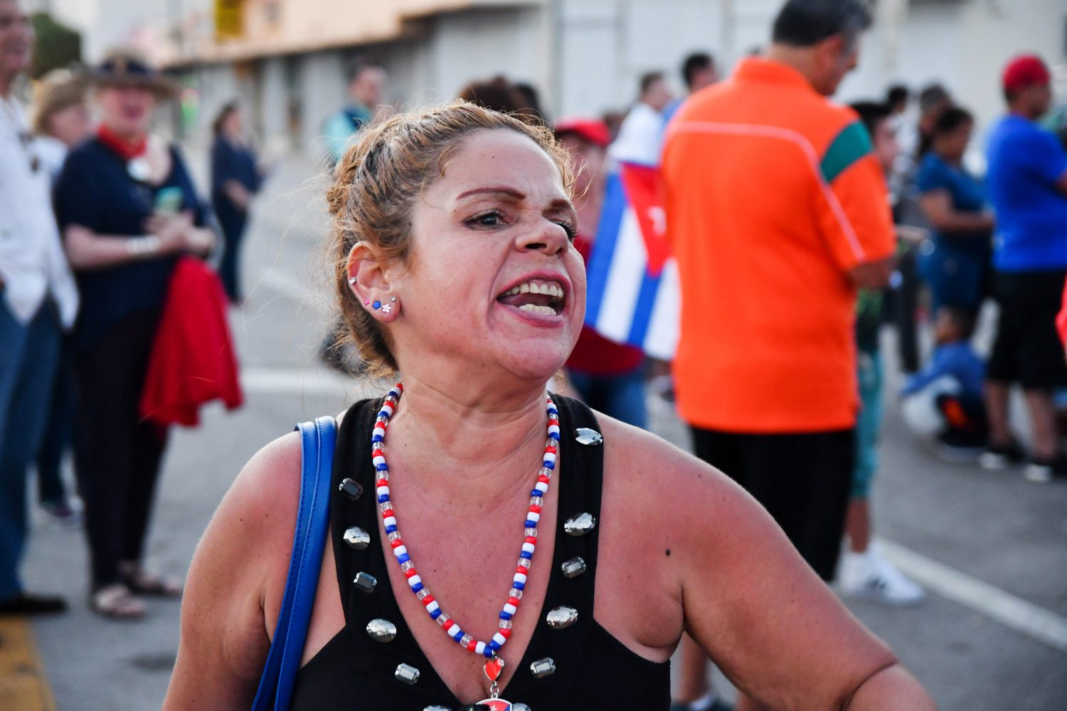 "Cuban-American Carmen Valdes walks up and down Calle Ocho passionately chanting ""We believe in Trump."" She's thankful he won the presidency because he ""hides secrets from no one."" (Grace King/ WUFT News)"