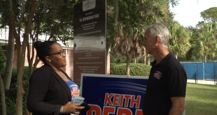 Keith Perry (right) talks with a supporter today at the McPherson Recreation Center precinct on Southeast 15th Street in Gainesville. His race against Rod Smith for the state Senate District 8 seat has been an intense one, with both candidates raising more than $700,000. (Alexa Lightle/WUFT News)