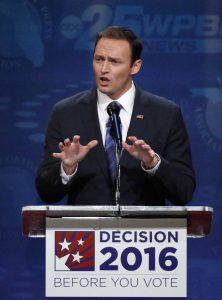 In this Oct. 26, 2016 file photo, U.S. Rep. Patrick Murphy gestures as he speaks during a debate against Sen. Marco Rubio, at Broward College in Davie, Fla. The Florida Senate race between Republican incumbent Marco Rubio and Democratic U.S. Rep. Patrick Murphy is as much about presidential nominees Donald Trump and Hillary Clinton as it is about differences between the candidates. (AP Photo/Wilfredo Lee, File)