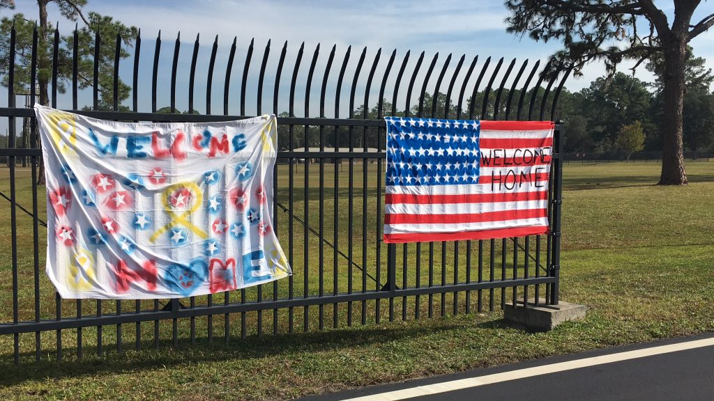 Banners are hung on the outer gates of Camp Blanding Joint Training Center in Starke on Friday in anticipation of its annual Veteran's Day ceremonies. Nearly 150 people attended the event and heard from Gary Newman, a Vietnam veteran. (Gabriela DeAlmeida/WUFT News)