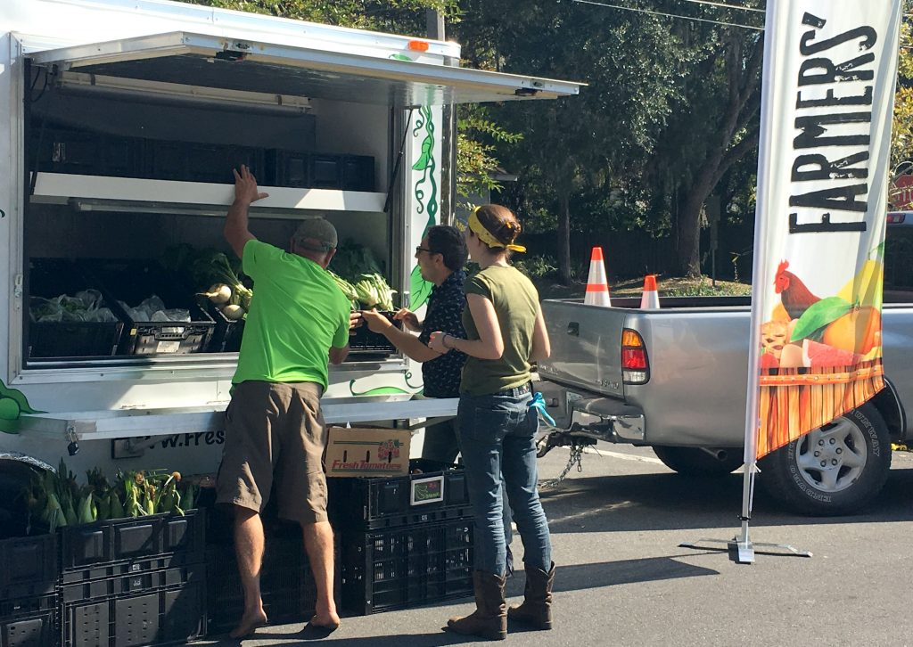 Fresh Wagon workers set up the mobile market in Oak Park's parking lot Thursday at 1 p.m., with Its next stop being Woodland Park. Friday it headed toward Sunshine Park and Pine Meadows to sell more fresh produce to public housing residents. (Victoria Todd/WUFT News)