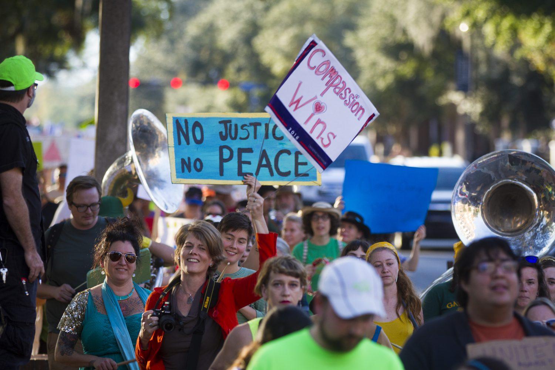 The protestors walk along University Avenue. (Michael Stone/WUFT News)