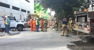 Emergency responders stand at the site of today's gas leak near the University of Florida. The pipe was repaired by 2:30 p.m. (Amalie Batchelder/WUFT News)