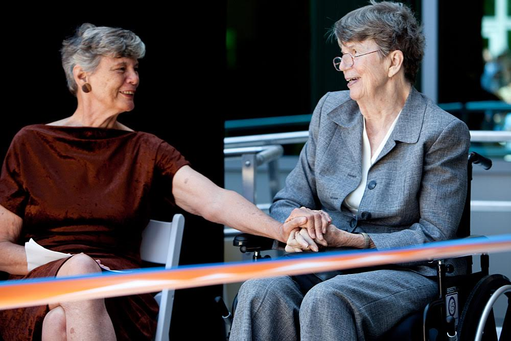 Reno and her sister, Maggy Hurchalla (left), attend the grand opening of UF's
