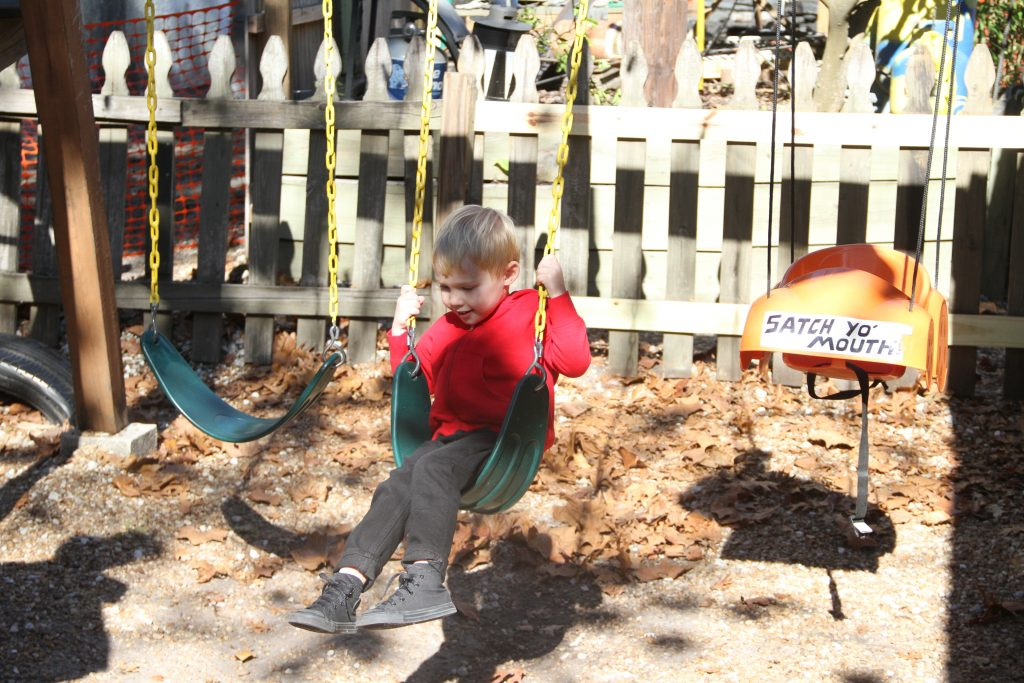 9.Henry, Kerri Audette's three-year-old son swings on the swingset at the playground next the the restaurant. Audette said they were regulars at Lightnin' Salvage's monthly trivia nights, and Henry loved the playground at Lightnin' Salvage that burnt down on Monday. (Antara Sinha/WUFT News)