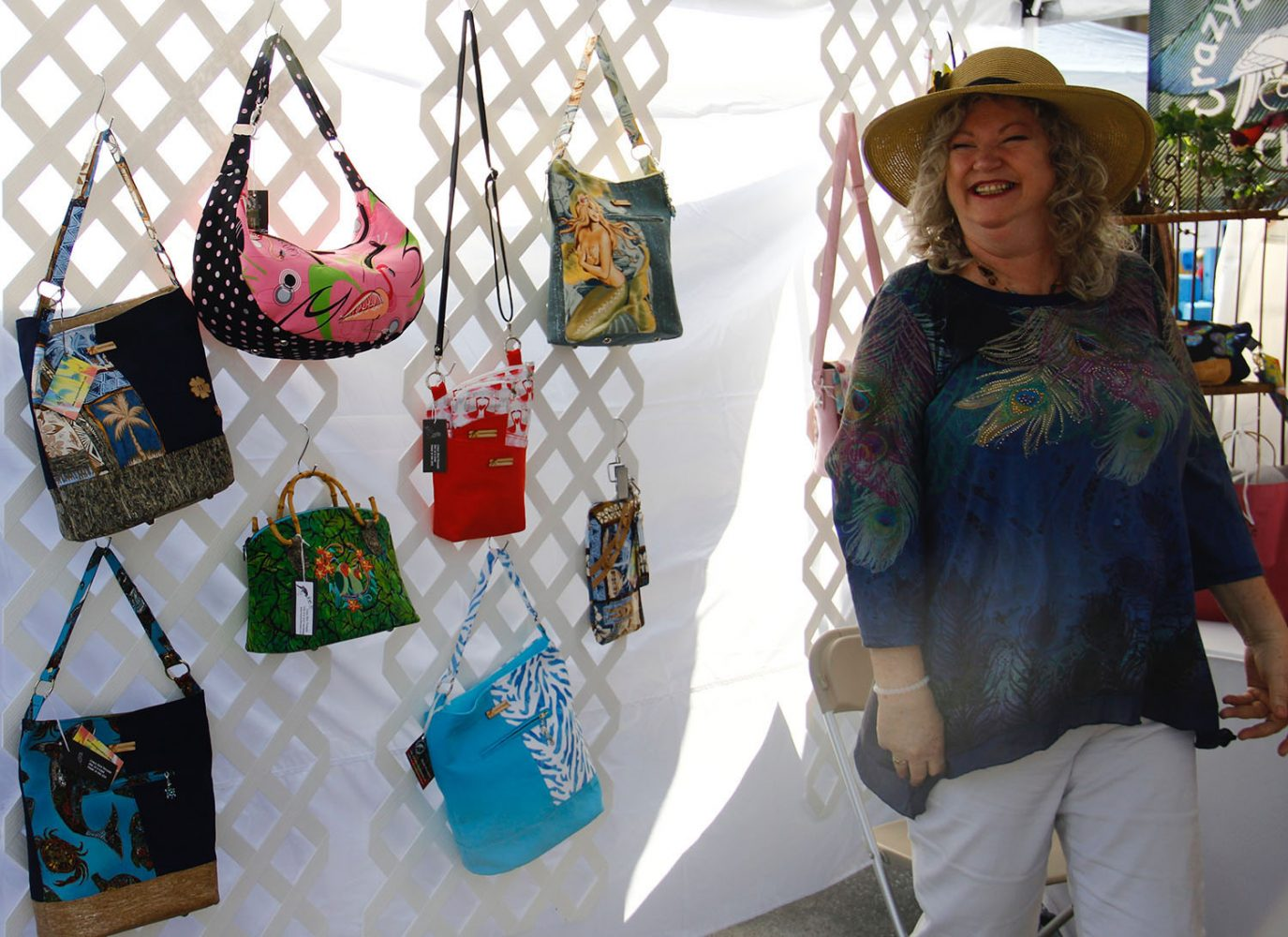 Karan Newman, a local artist, crafts purses inspired by her love of birds and of the Florida Keys. (Photo by Lauren Gandy/WUFT News)