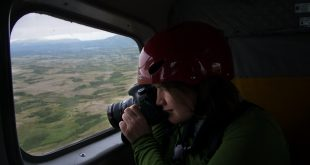Gabby Salazar shoots from the plane en route to an expedition through Alaska's Katmai National Park and Preserve. (Jennifer Adler/WUFT News)