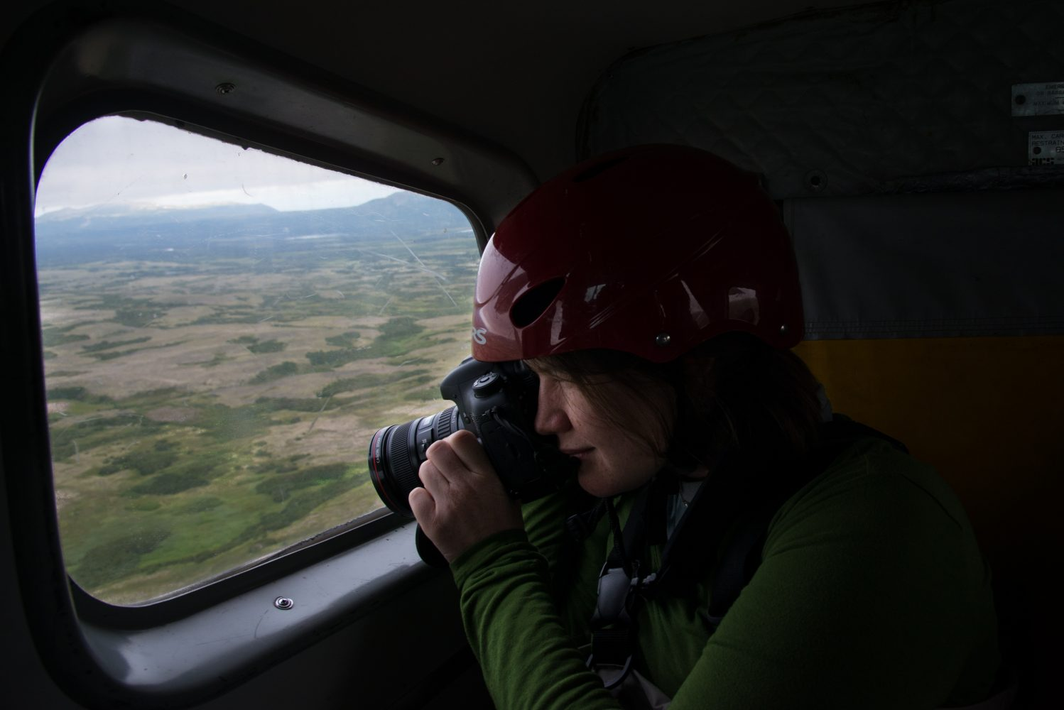 Photo by Jennifer Adler: Gabby Salazar shoots from the plane en route to an expedition through Alaska's Denali National Park.