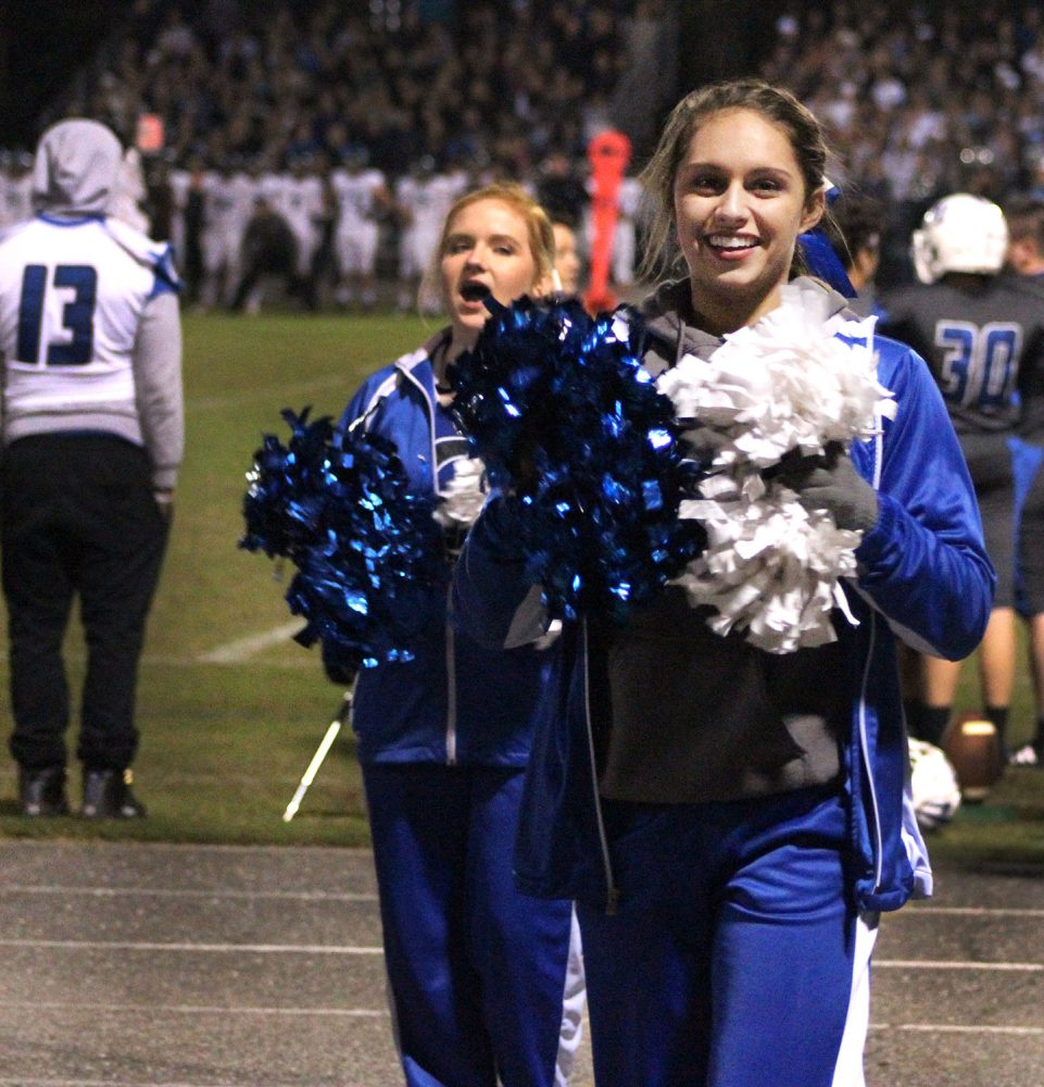 Clay County High School cheerleader Carlie McRae cheers toward the end of the game. (Catherine Dickson/WUFT News)