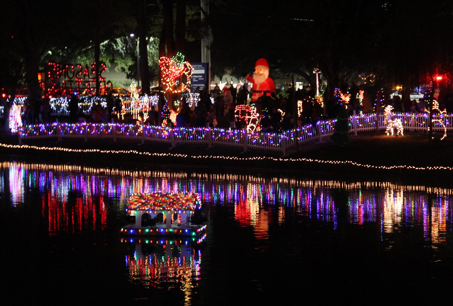 A display of 80,000 lights and dozens of famous figures light up Duck Pond for the 27th Annual Pond Lighting Festival hosted by the North Florida Regional Medical Center Friday night. (photo by Visshaael Patel)