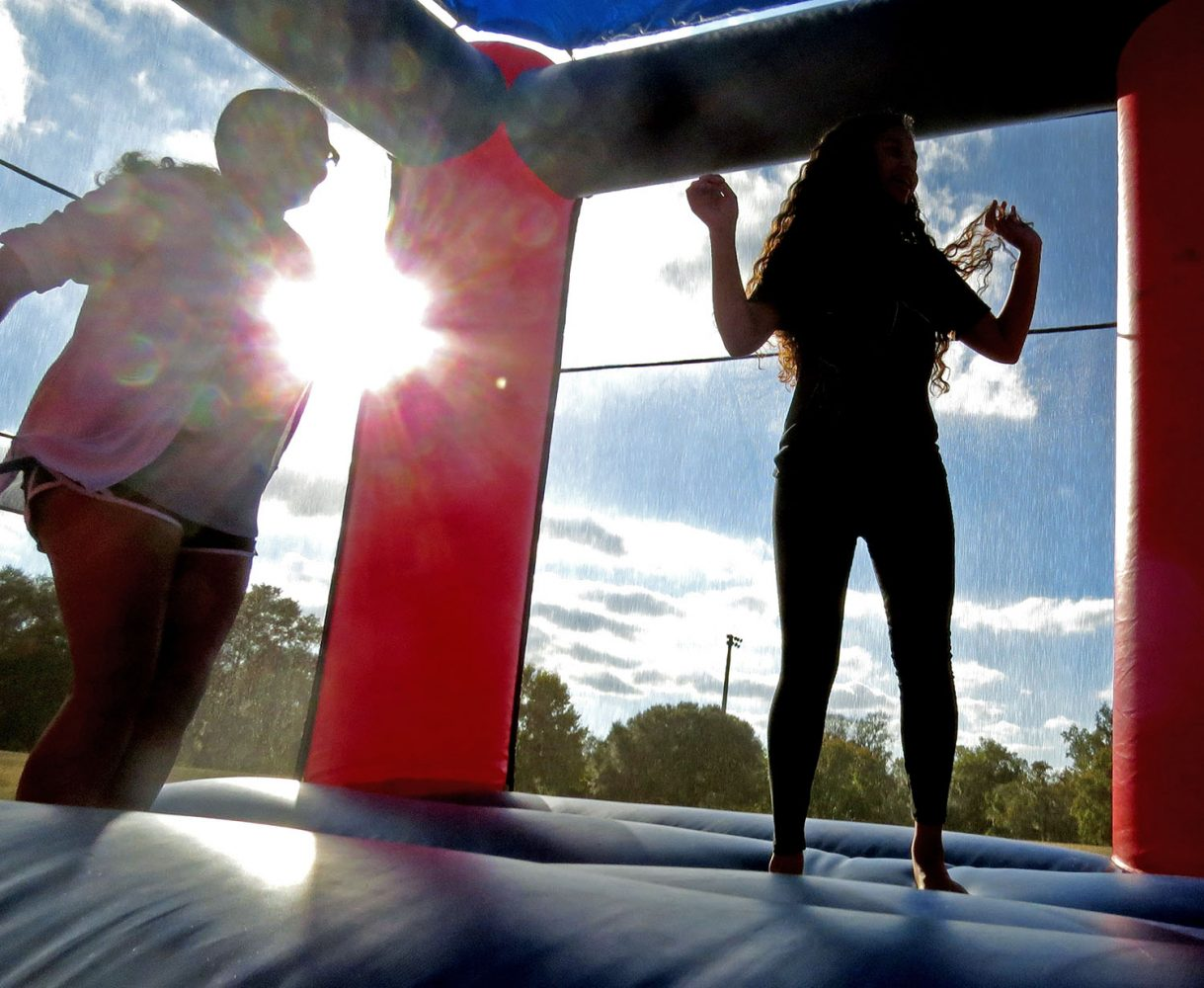 JUMPING STRESS AWAY- UF students jump in a bounce house during Keys Governing Body's Bounce Your Stress Away event on Sunday, December 4, 2016. (photo by Katelyn Newberg)