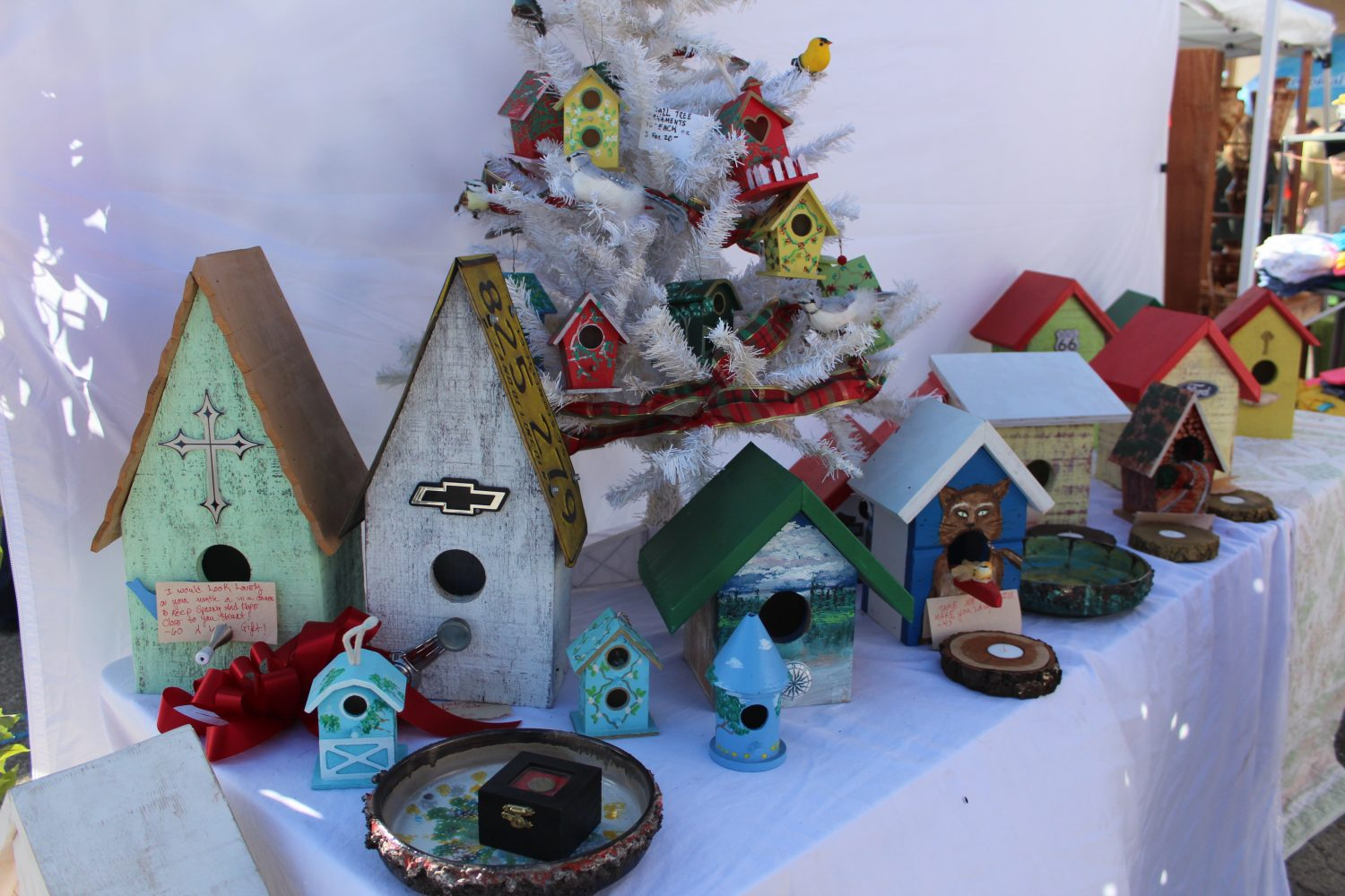 Birdhouses hand-painted by Raquelle Crusado. Crusade picked up the hobby for therapeutic reasons after a traumatic injury. (Photo by Sophie Smadbeck/WUFT News)