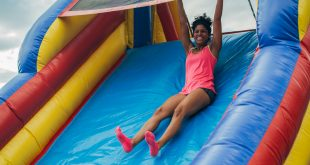 Thalia Castro slides down the large bounce house obstacle course. (photo by Steele Friese)